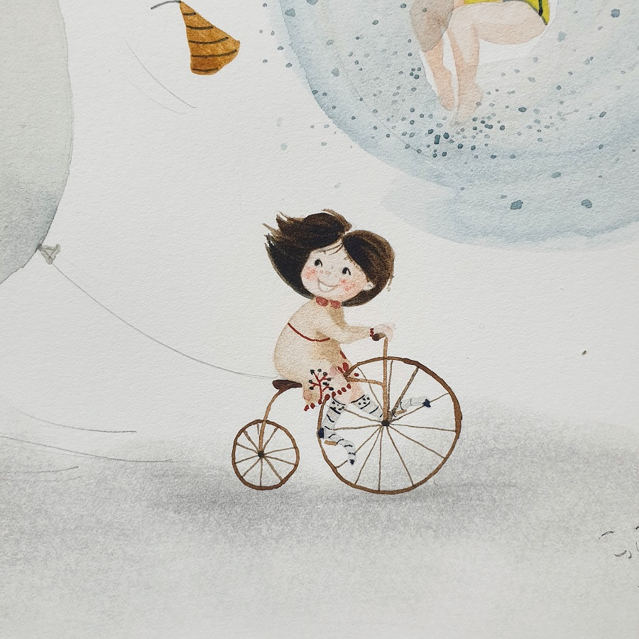 Girl on a bicycle with a balloon